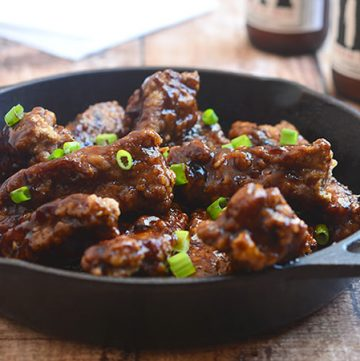 Coffee Ribs fried until golden and crisp and then coated with coffee flavored sauce for an Asian-inspired appetizer or dinner meal. Moist, tender, and flavorful, they're finger-licking delicious!