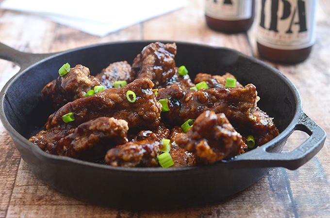Asian Coffee Ribs fried until golden and crisp and then coated with coffee flavored sauce for an Asian-inspired appetizer or dinner meal. Moist, tender, and flavorful, they're finger-licking delicious!