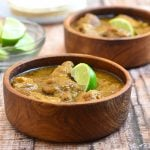 Pork Chili Verde made with pork ribs in a spicy tomatillo sauce. Hearty and delicious, this spicy stew is amazing with rice and warm corn tortillas!