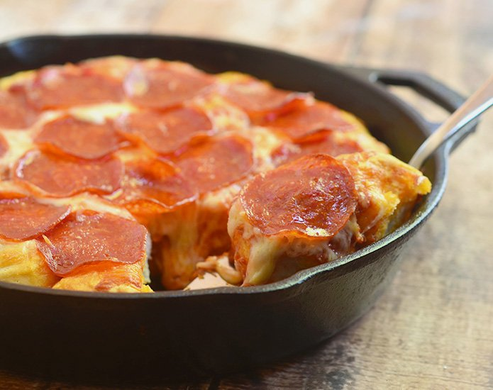 Bubble Pizza is a quick and easy pan pizza made with only 4 ingredients and in less than 30 minutes! It's fun party or snack option everyone will devour!