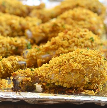 Cornflake chicken coated in cornflake crumbs for crunchy, juicy chicken perfection without deep-frying. Loads of flavor with less work and less fat!