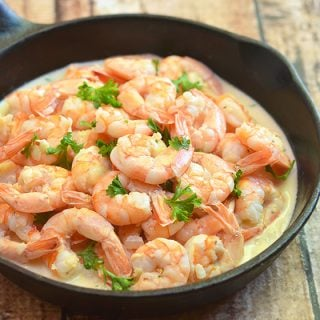 Creamy Vodka Lime Shrimps made with plump shrimps cooked in a delectable vodka sauce. It's amazing over rice, pasta or sopped up with crusty bread rolls.