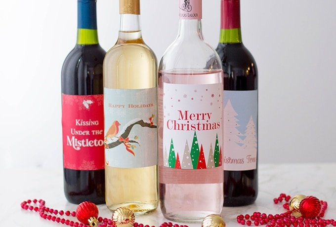 four bottles of wine with Christmas labels