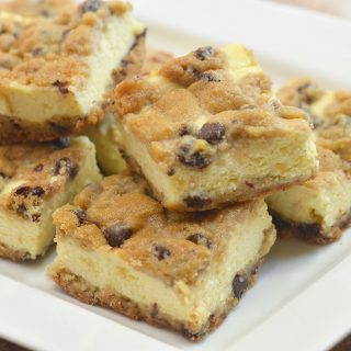 Chocolate Chip Cookie Cheesecake bars with creamy cheesecake filling sandwiched between chewy chocolate chip cookie layers. They're a delicious marriage of two all time favorites!