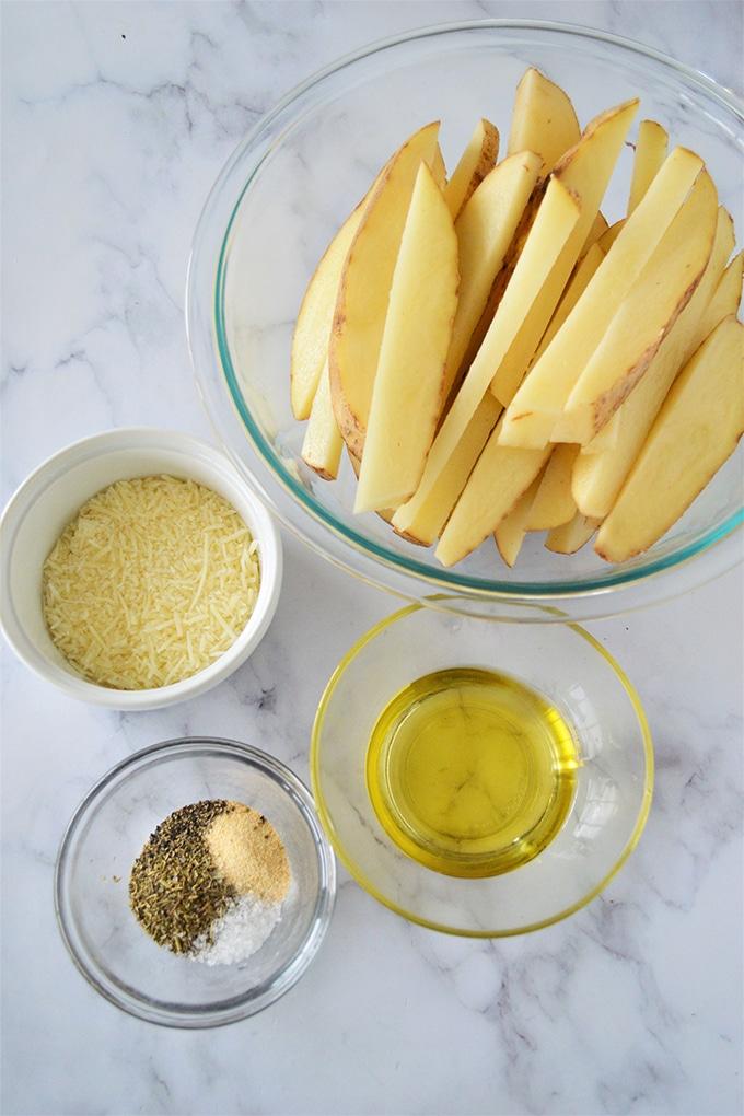 cut-up potatoes in wedges, olive oil, Parmesan cheese, seasonings