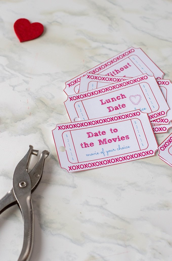 Use a hole punch to create a coupon book of romantic love coupons.
