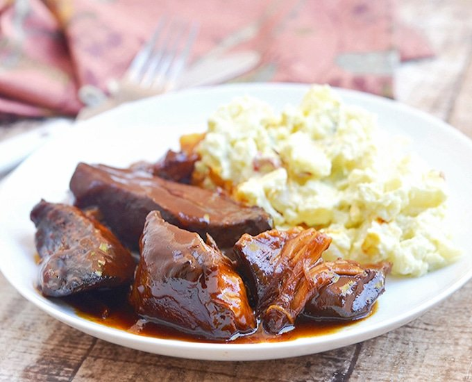 Slow Cooker BBQ Country Style Ribs with homemade BBQ sauce cooked to perfection in the crockpot. They're melt-in-your-mouth tender and loaded with sweet and tangy flavors!
