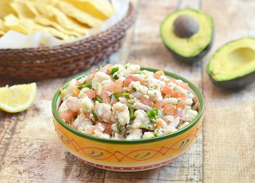 Shrimp Ceviche that's refreshingly tangy, slightly spicy, and served up with creamy slices of avocado and crisp tortilla chips. It's a delicious way to cool off this summer!