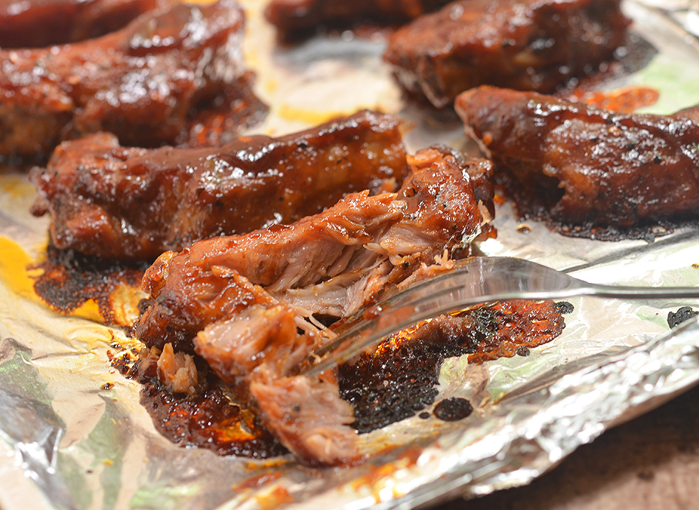 Oven-Baked Baby Back Ribs with Coffee Whiskey Barbecue Sauce are super easy to make yet moist, flavorful and fall-off-the-bone tender. They're finger-licking, lip-smacking amazing!