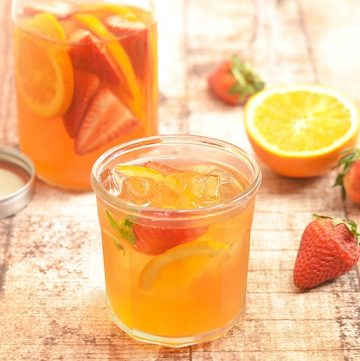 Refrigerator Iced Tea with oranges and strawberries