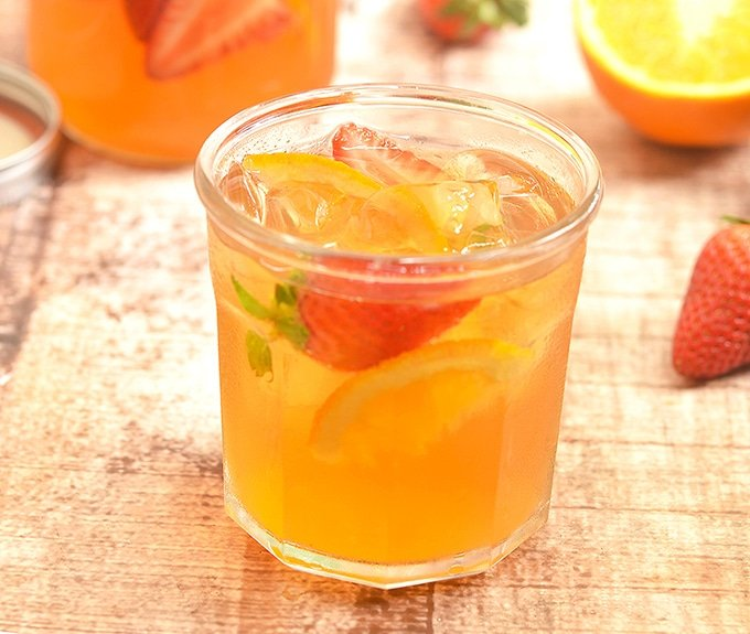 Cold Brew Iced Tea with oranges and strawberries