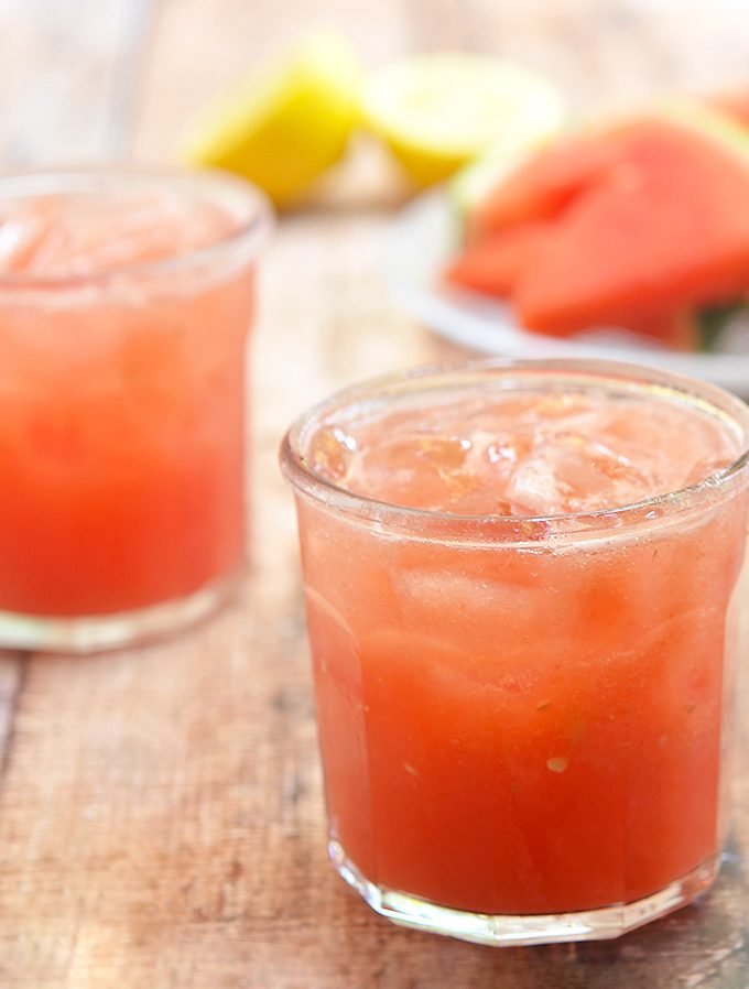 Watermelon Lemonade with dewy watermelon and freshly-squeezed lemon juice. Sweet, tangy and icy cold, it's the best way to keep cool this summer.