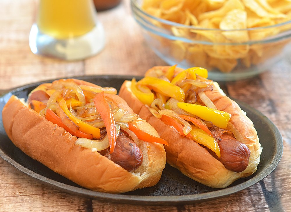 Bacon-Wrapped Hot Dogs are called danger dogs for a reason. Wrapped in smoky bacon and loaded with caramelized onions and peppers, they're dangerously delicious!