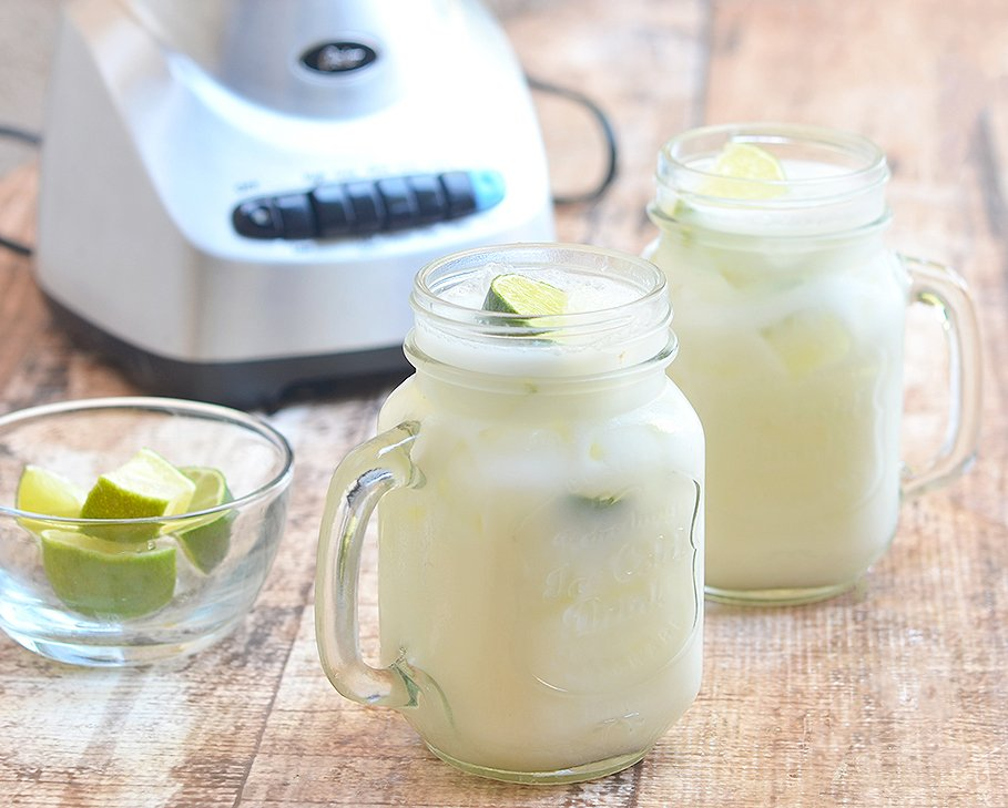 Creamy condensed milk is blended with fresh limes for a sweet and tangy summer drink