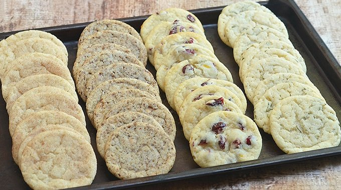 4 cookie flavors using refrigerated sugar cookie dough on a baking sheet