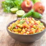 nectarine salsa made with nectarines, lime, cilantro, and jalapenos in a ceramic serving bowl