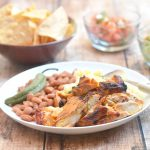Pollo Asado marinated in citrus juices and spices is delicious fresh off the grill and leftovers are amazing in tacos, burritos or quesadillas!