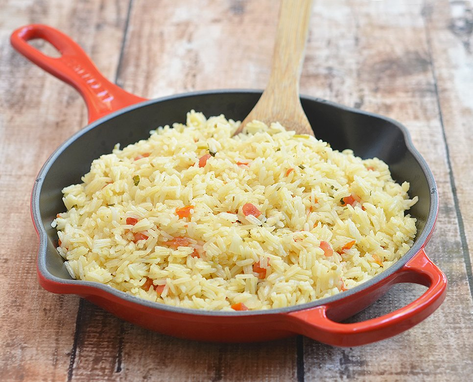 One-pan Spanish rice is seasoned with fresh tomatoes, onions, garlic, cilantro, and lime juice.