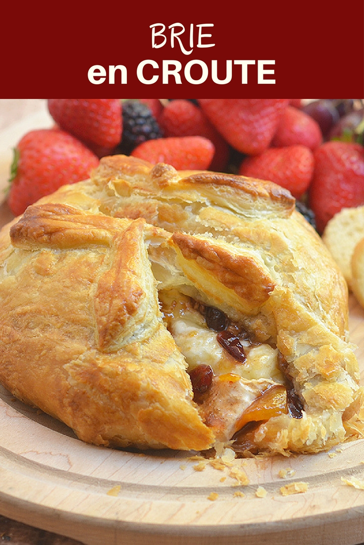 Brie En Croute with brie cheese, apricots, and nuts baked in a golden flaky puff pastry. It's an impressive appetizer your guests would be lining up for seconds!