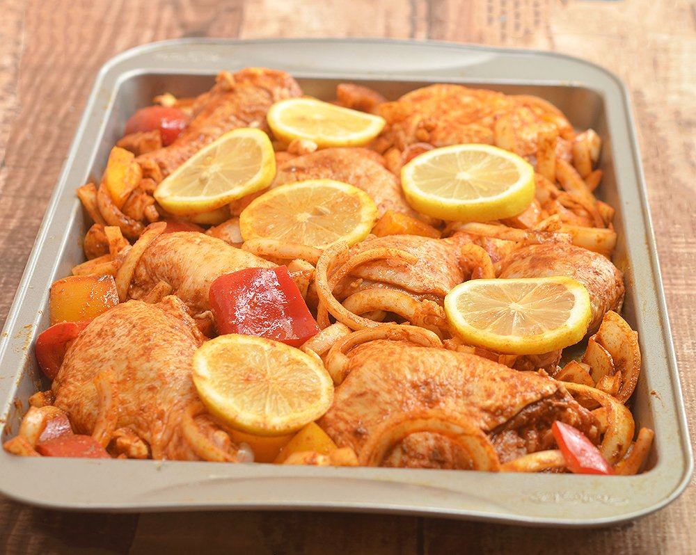 Roasted Chicken with Sweet Onions with sweet onions and peppers, lemon, and spices. This Peruvian-style roasted chicken has loads of flavor without the extra effort!