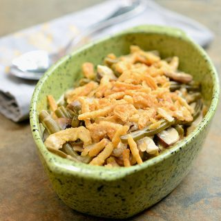 Slow Cooker Green Bean Casserole with tender green beans, mushrooms, and crispy french-fried onions has all the delicious flavors of your favorite Thanksgiving side dish but without the work!