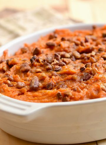 Sweet Potato Casserole with Rum and Candied Pecans is a must-have holiday side dish. Fluffy with a spike of rum flavor and crunchy sweet pecan topping, it's the perfect accompaniment toThanksgiving turkey or Christmas ham.