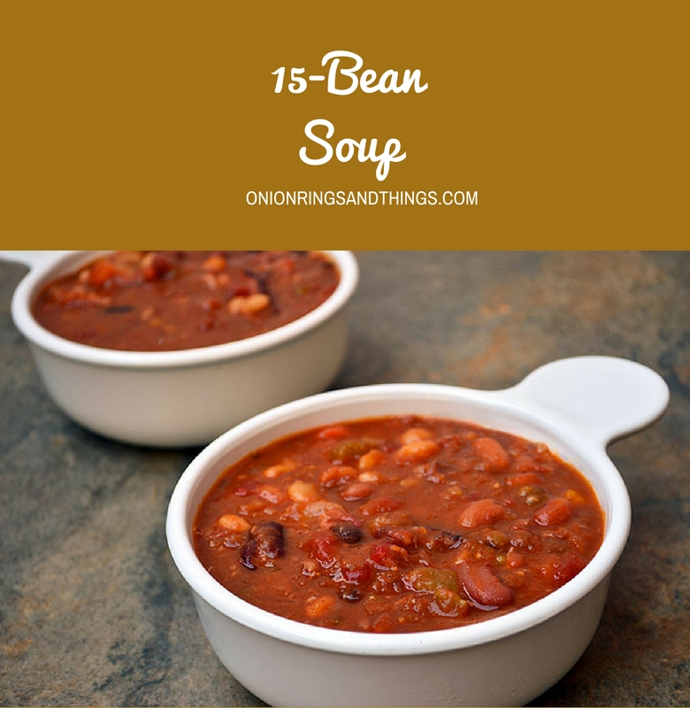 15-Bean Soup with Ham made with assorted beans, diced tomatoes, and smoky ham. Kicked up with Cajun seasonings, it's thick, hearty, delicious and the perfect use for your leftover ham!