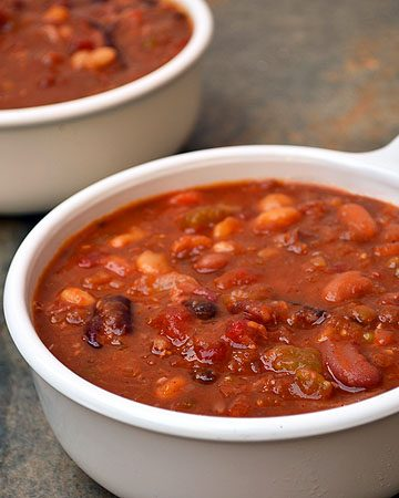 15-Bean Soup with Ham with assorted beans, ham, tomatoes, and Cajun spices for the ultimate cold weather comfort food. It's thick, hearty, delicious and the perfect use of your leftover ham!