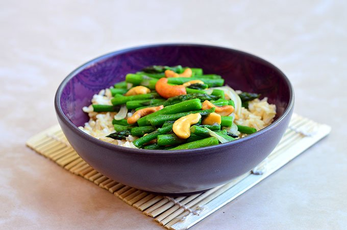 Asparagus and cashew stir-fry with tender-crisp asparagus and crunchy cashews served over nutty brown rice. A vegan dish that's as nutritious as it is delicious!