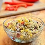 Southwestern Quinoa Salad with quinoa, black beans, corn, bell peppers and lime dressing. Bursting with southwestern flavors, this side dish is delicious as it's nutritious.