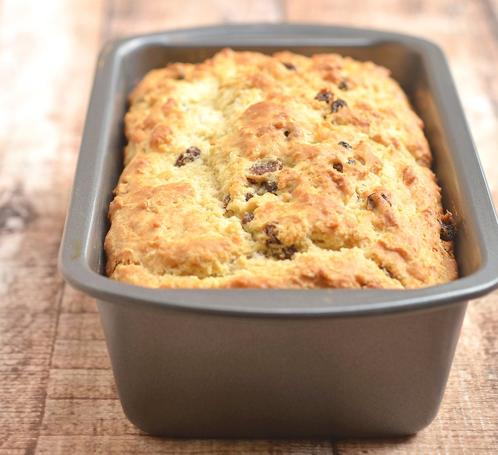 Irish Soda Bread baked in a loaf pan. Golden, moist and studded with raisins, perfect for St. Patrick's Day!