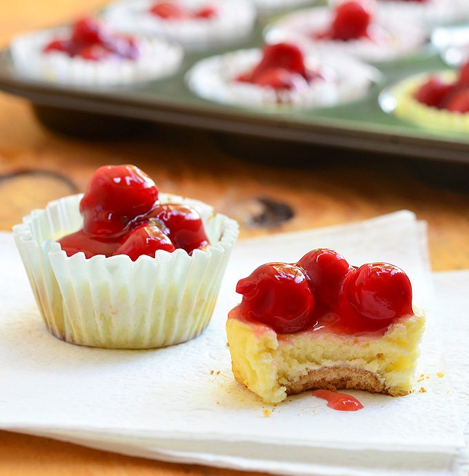 Mini Cherry Cheesecakes with vanilla wafer crust, creamy cheesecake, and cherry topping are as easy to make as they are delicious. They're the perfect-sized sweet treat for one but are just as amazing for a large crowd!