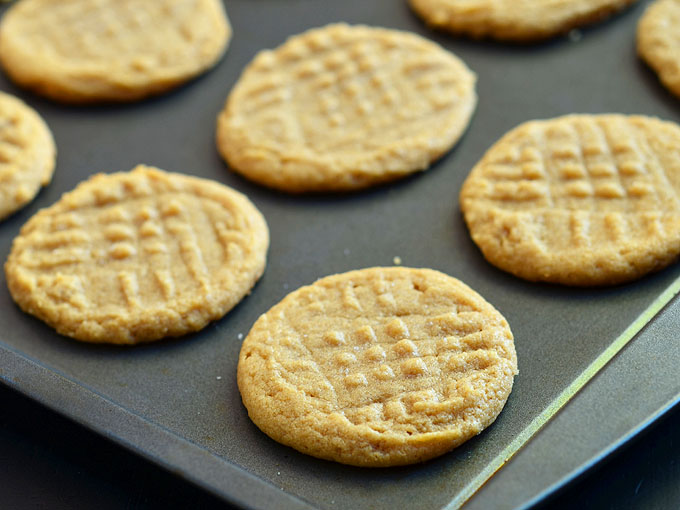Flourless Peanut Butter Cookies with only three ingredients! Just eggs, sugar, and peanut butter to make the most amazing gluten-free treat!