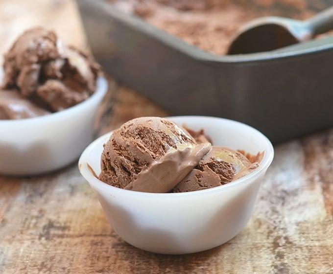 Chocolate ice cream in white dessert bowls