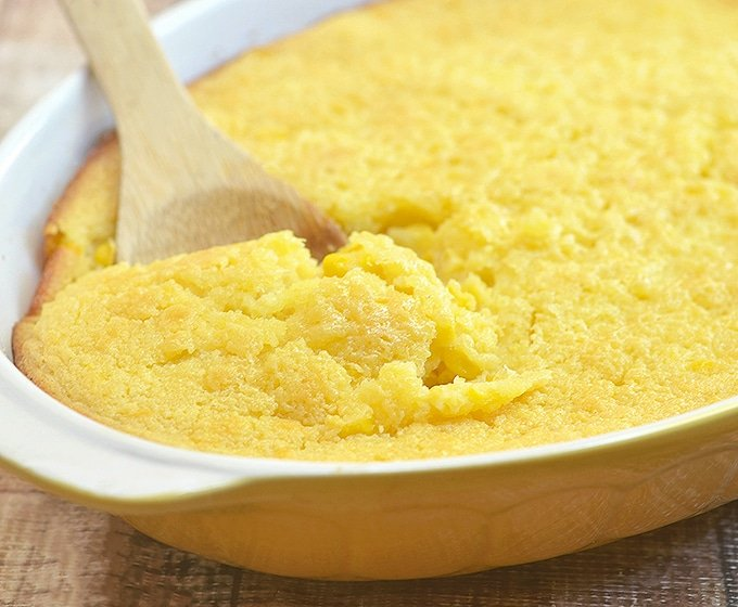 sweet corn spoonbread in a yellow casserole dish