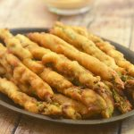 Beer-Battered Asparagus with a golden and crisp beer batter. Crunchy and delicious with a campfire dipping sauce, this appetizer is a sure party hit!