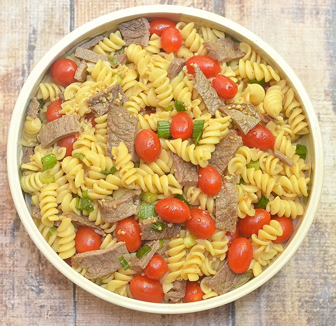 Mongolian Beef Pasta Salad with tomatoes, beef and green onions