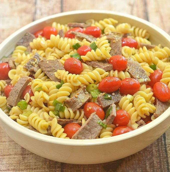 Beef and Pasta salad with grape tomatoes, green onions and savory sauce