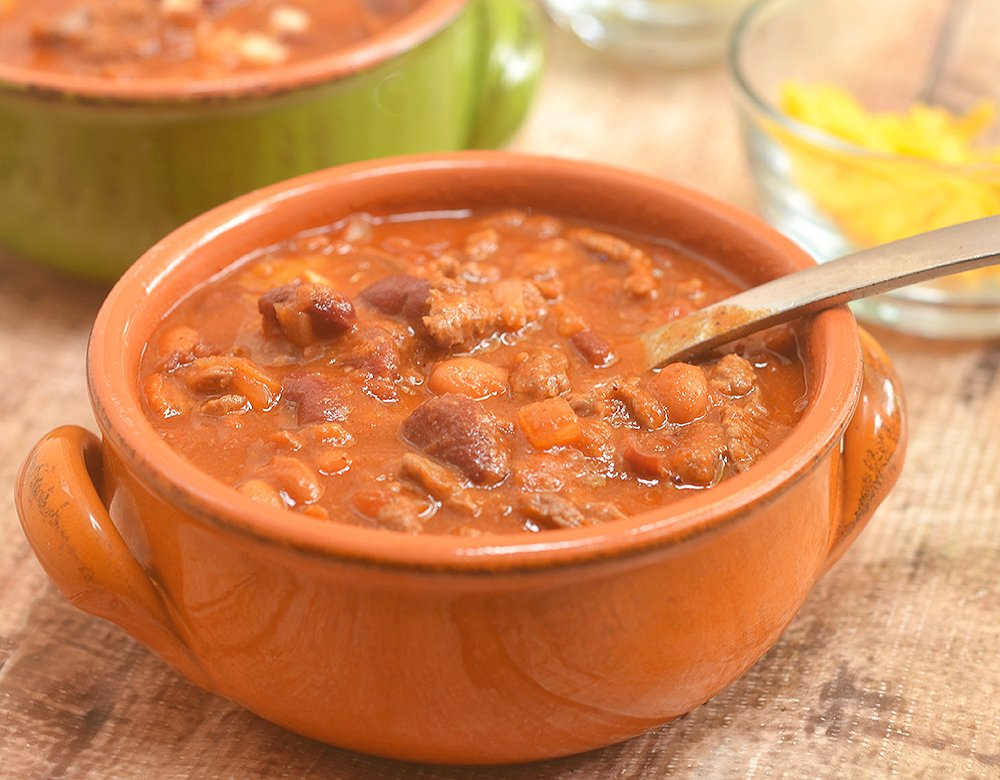 Cowboy Steak Chili with diced beef and tender beans in a smoky, chili-spiced tomato gravy is the ultimate chilly day food. Serve with cornbread for a hearty dinner or set out with various fixings for DIY game day eats!