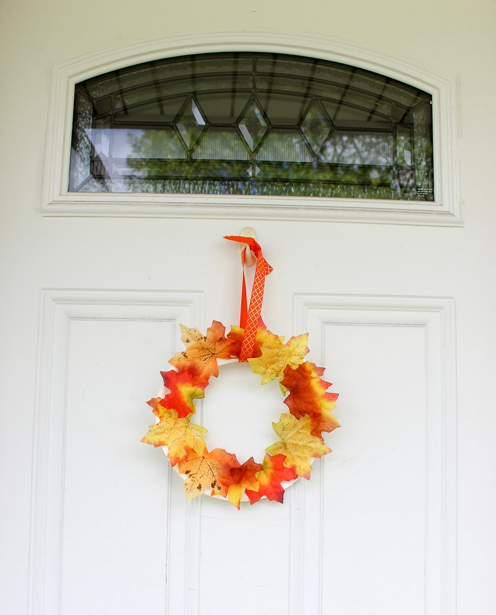 DIY Fall Wreath to easily spruce up your home and add Autumn colors to your decor. It's quick and fun to make with the kids from Dollar Store supplies!