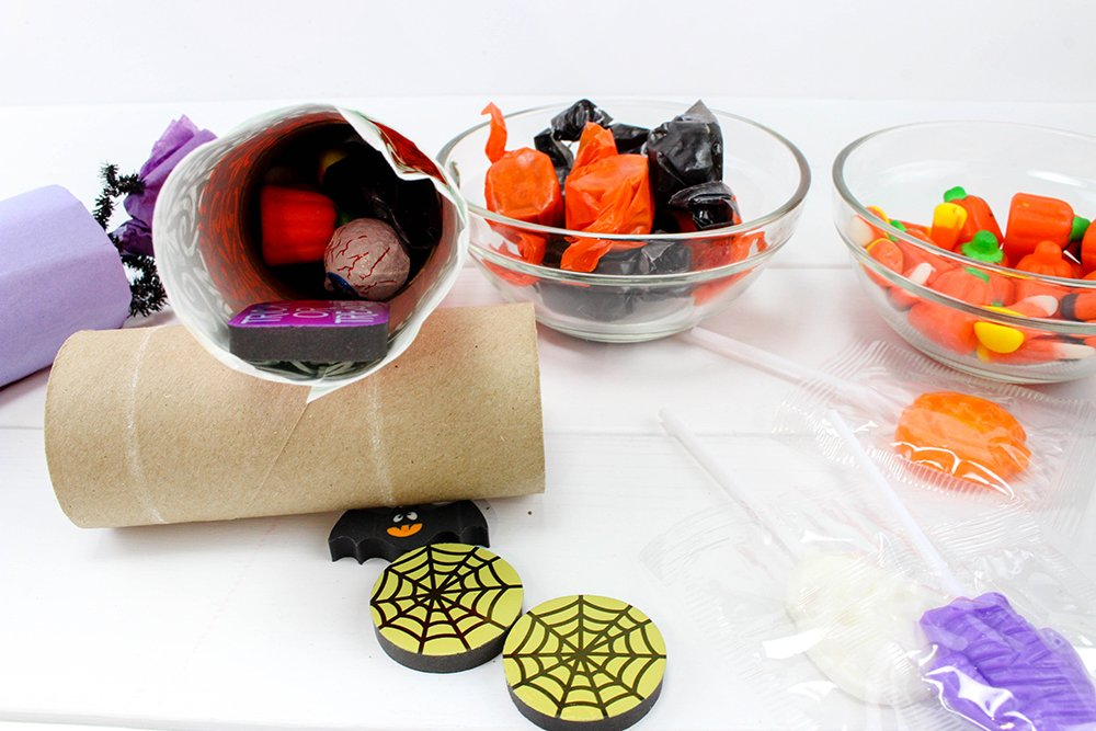 fill tubes with candies-are sure to take your trick or treat game to a whole new fun. Filled with candies and other goodies, they're the ultimate Halloween party favors!