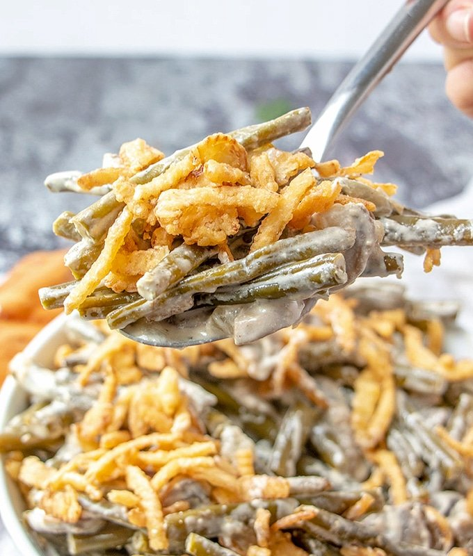 serving green bean casserole with a fork