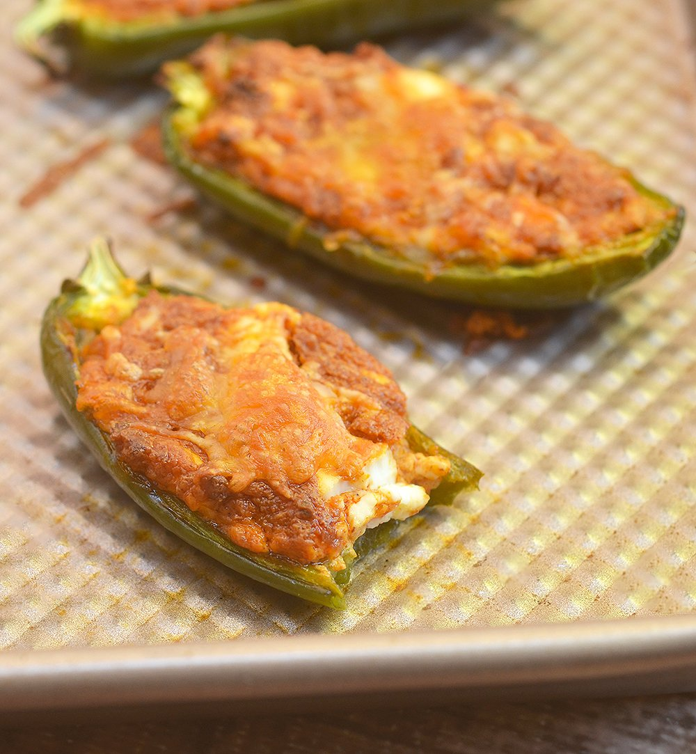 Stuffed Jalapeno peppers are creamy, spicy and seriously addicting. Perfect for game day!