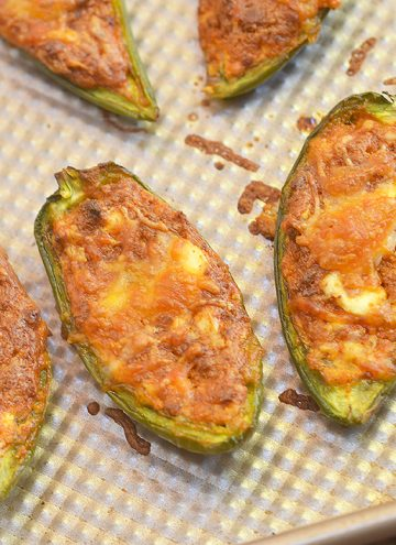 Chorizo-Stuffed Jalapeno Poppers filled with chorizo, cream cheese, and shredded Mexican cheese blend are the perfect game day eats! They're smoky, spicy, creamy and full of bold flavors you'll love in an appetizer!