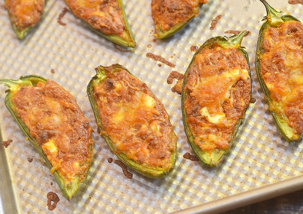 Chorizo-Stuffed Jalapeno Poppers filled with chorizo, cream cheese, and shredded Mexican cheese blend are the perfect game day eats! They're smoky, spicy, creamy and full of bold flavors you'll love in an appetizer!!