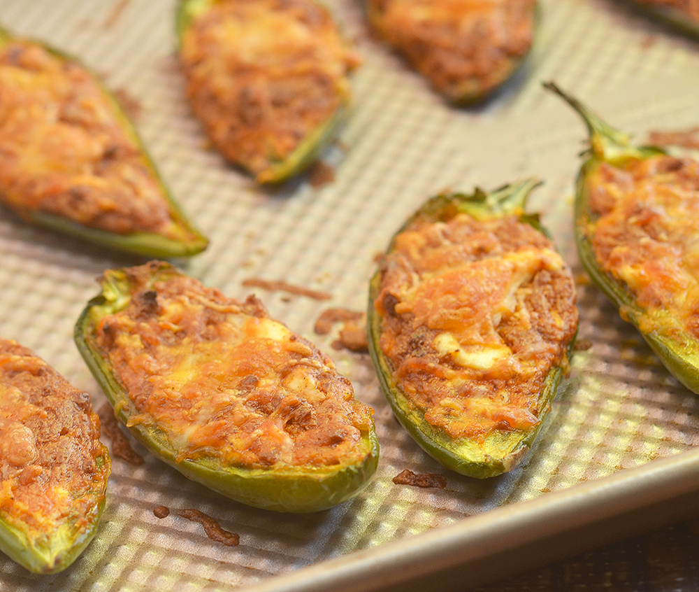 Stuffed Jalapenos with chorizo are easy to make yet absolutely addicting. They're creamy, spicy and bursting with bold flavors!