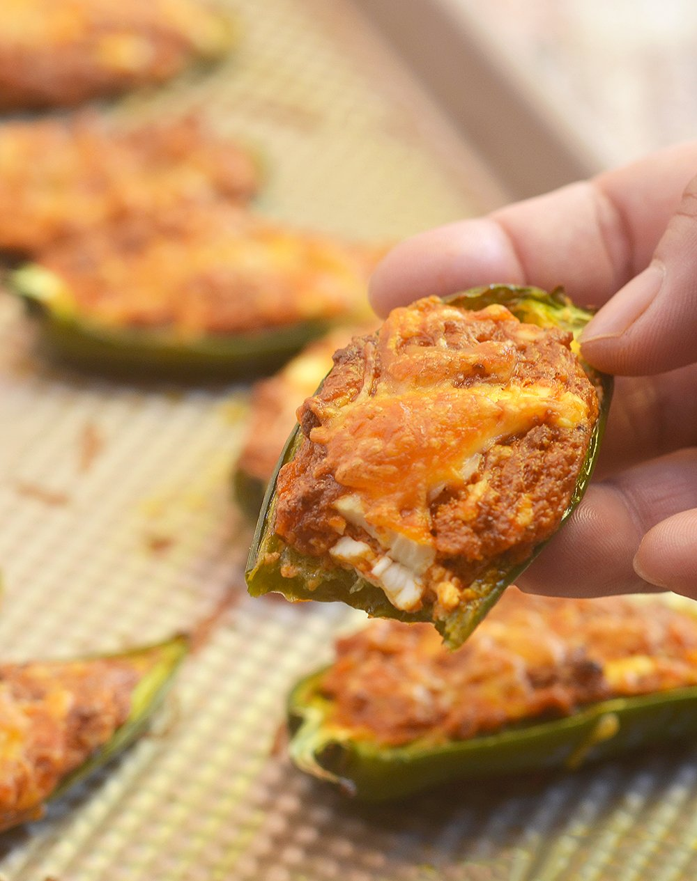 Mexican-style Jalapeno Poppers filled with crumbled chorizo, cream cheese, and shredded cheddar. They're spicy, creamy, and absolutely addicting!