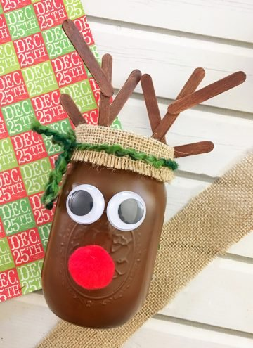 DIY Christmas Reindeer Mason Jar is perfect for holiday gift giving and home decorating. It's a fun and easy Christmas craft activity for the whole family!