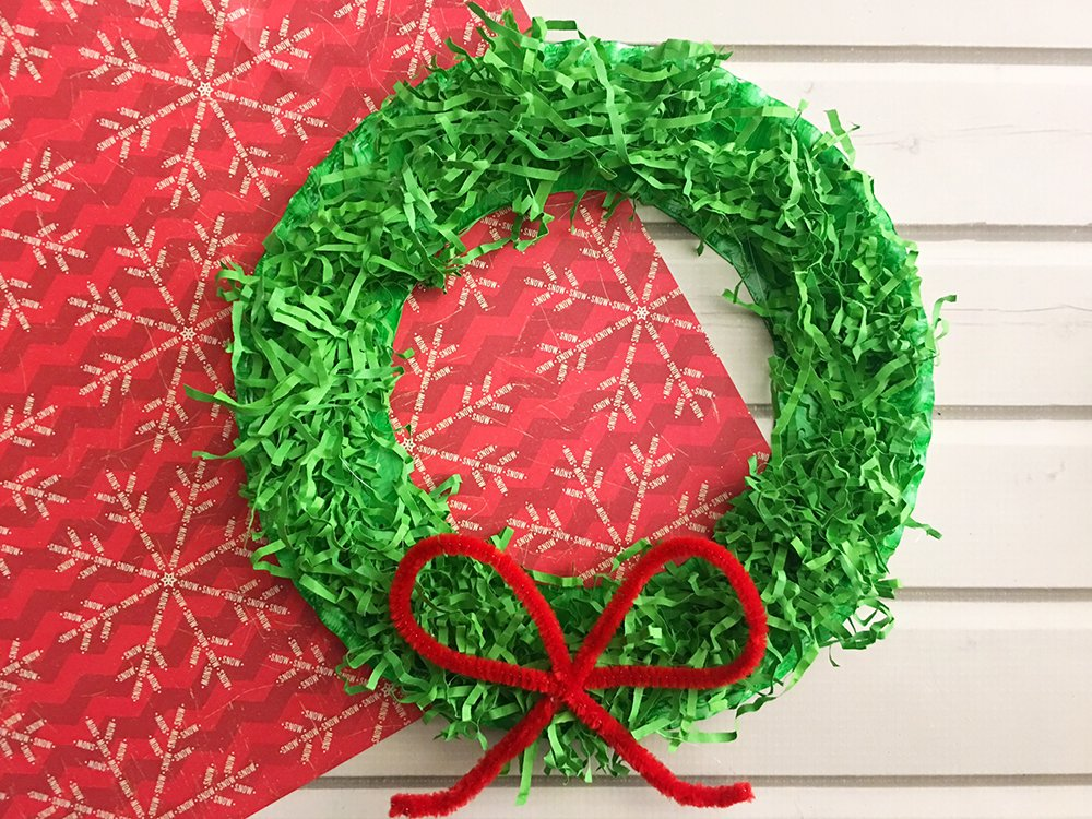 homemade christmas wreath made with paper plate and shredded crinkle paper is a fun craft activity - Diy Christmas Wreath