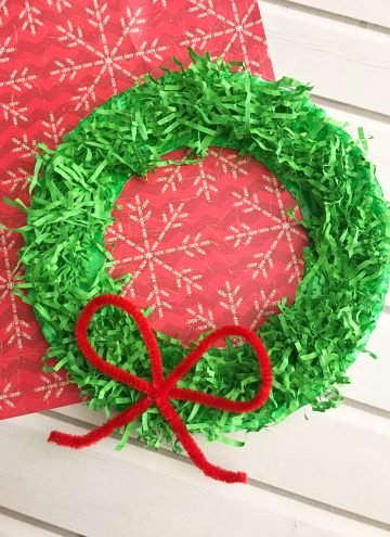 DIY Paper Christmas Wreath is a fun paper craft to do with the whole family. It's inexpensive to make and adds a festive touch to your holiday decor.